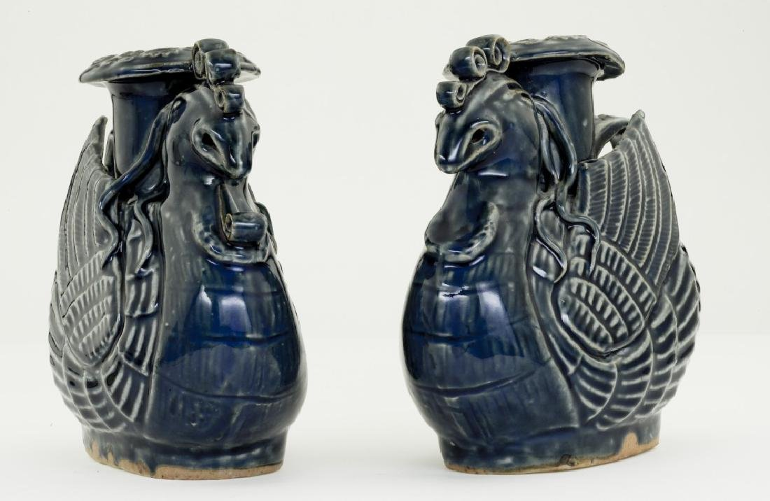 A pair Chinese bluish glazed candle- holders