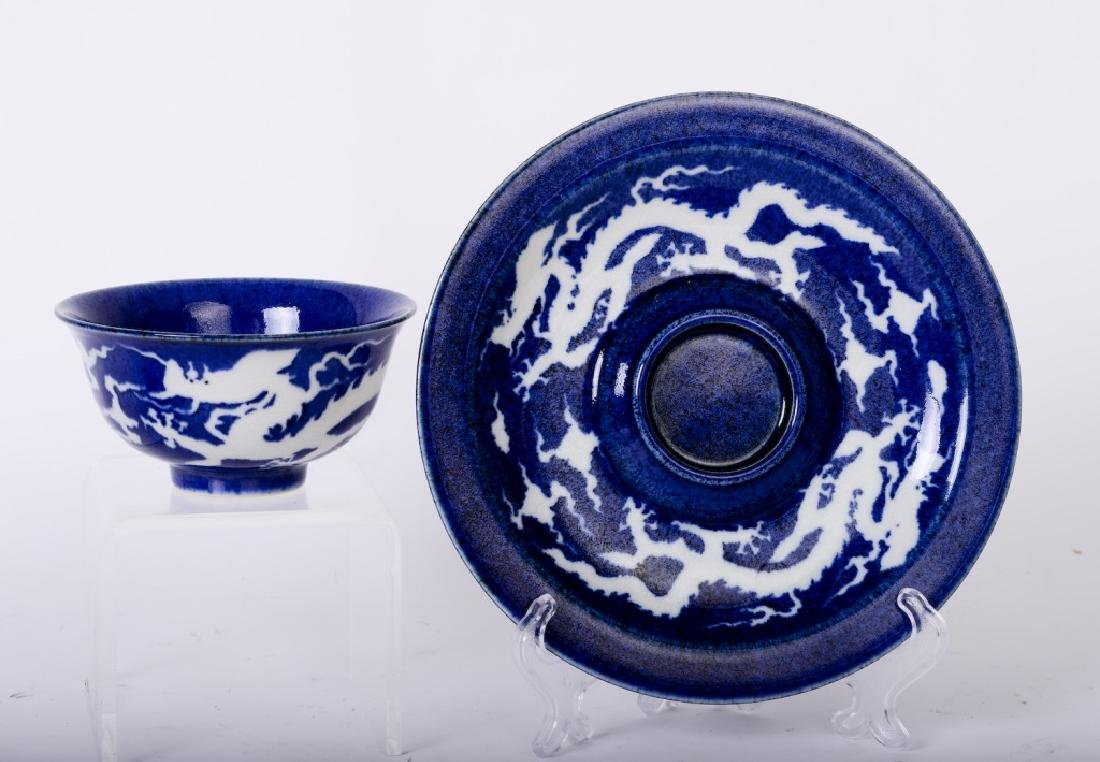 Set of two pieces of ceramic cup and sitting plate