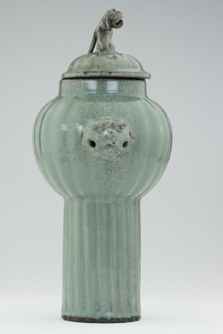 A Chinese Long Quan kiln lidded bottle vase