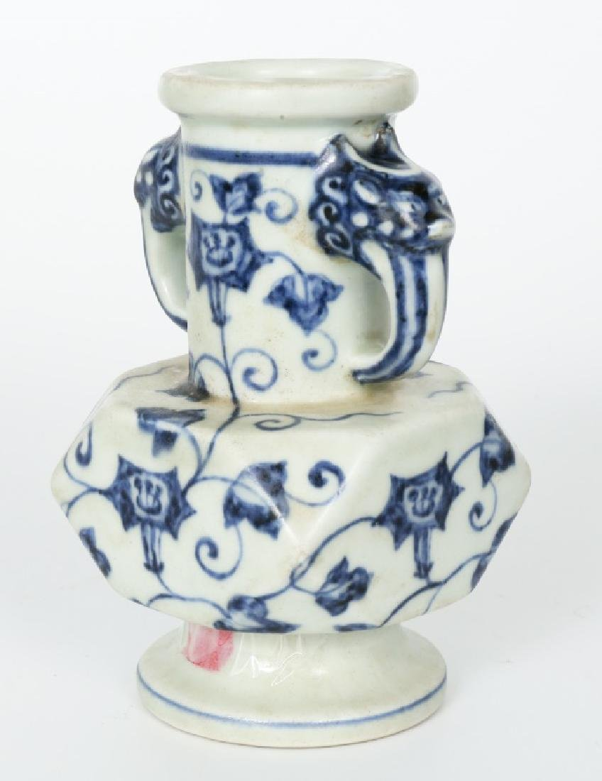 A Chinese Ming dynasty blue and white vase