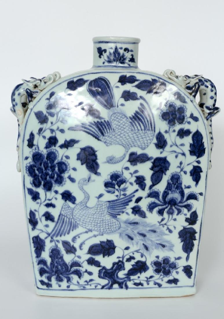 A Chinese Yuan dynasty blue and white bottle vase