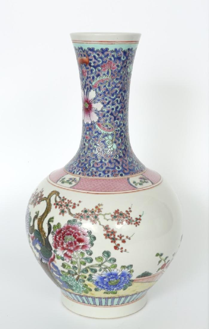 A Chinese Qing dynasty femille rose long neck vase