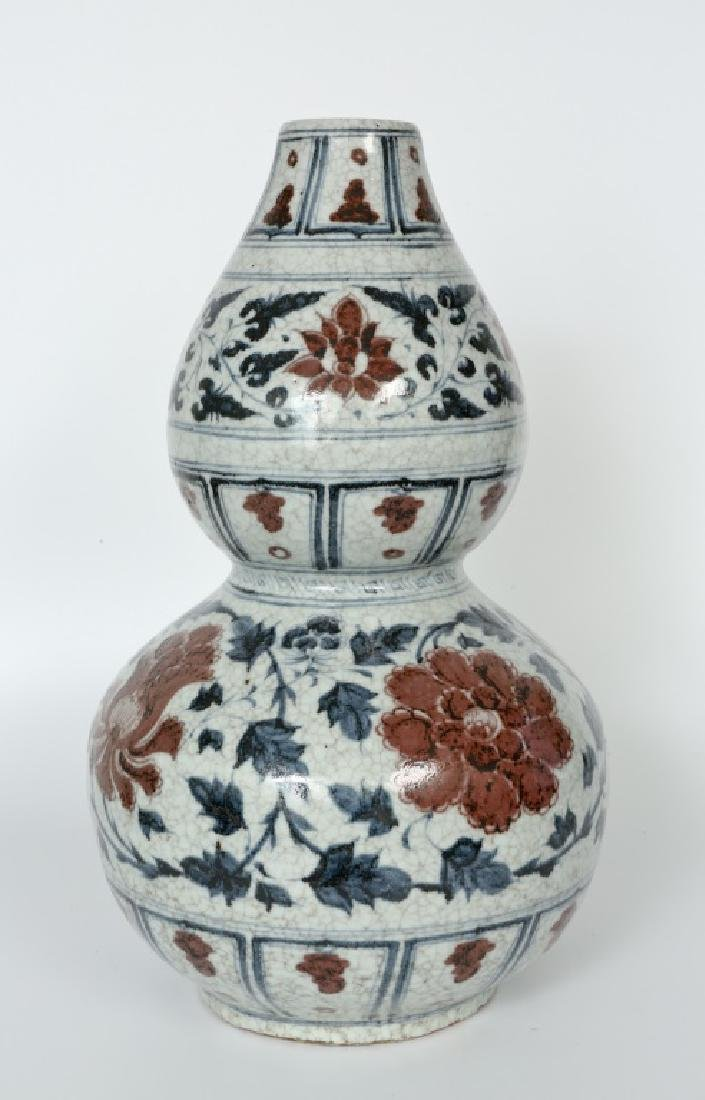 A Yuan dynasty blue underglaze red gourd vase