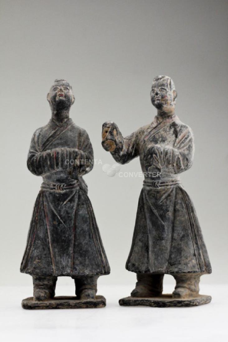 A pair of Han dynasty pottery officer figures