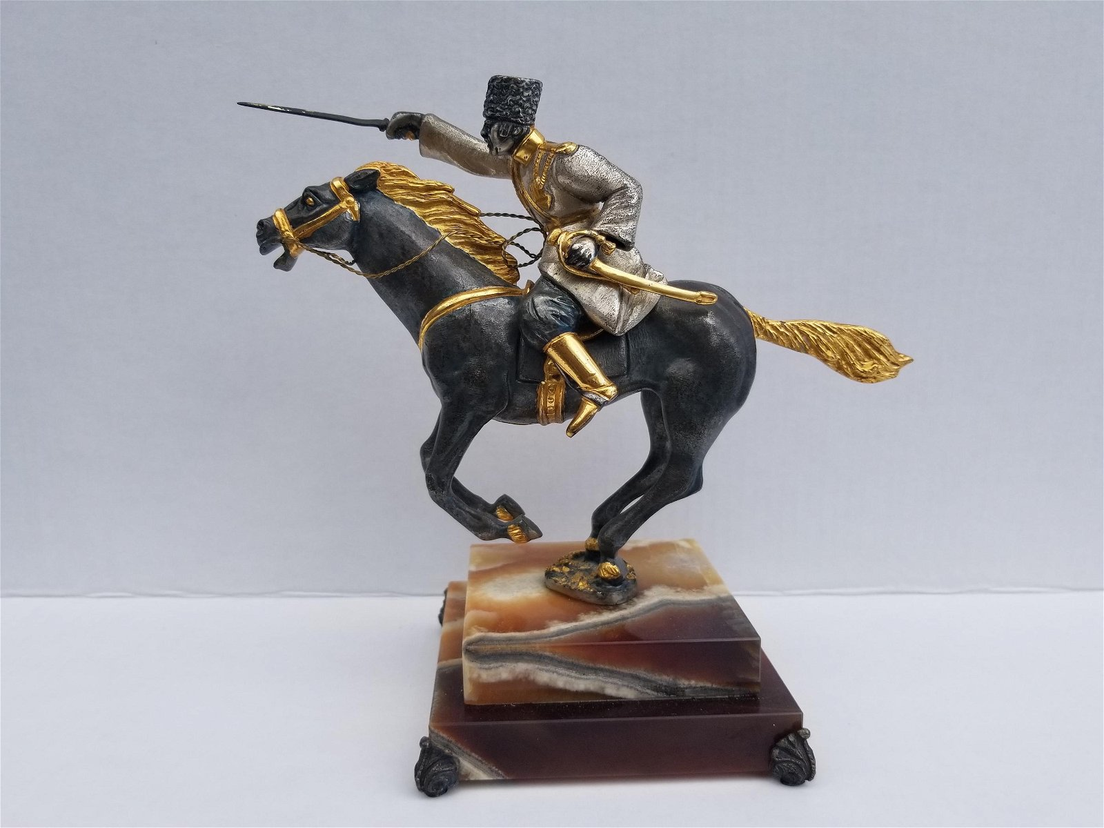 Iron statue on onyx, made in italy, limited edition