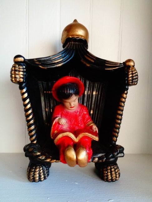 Antique Seated Asian porcelain figure