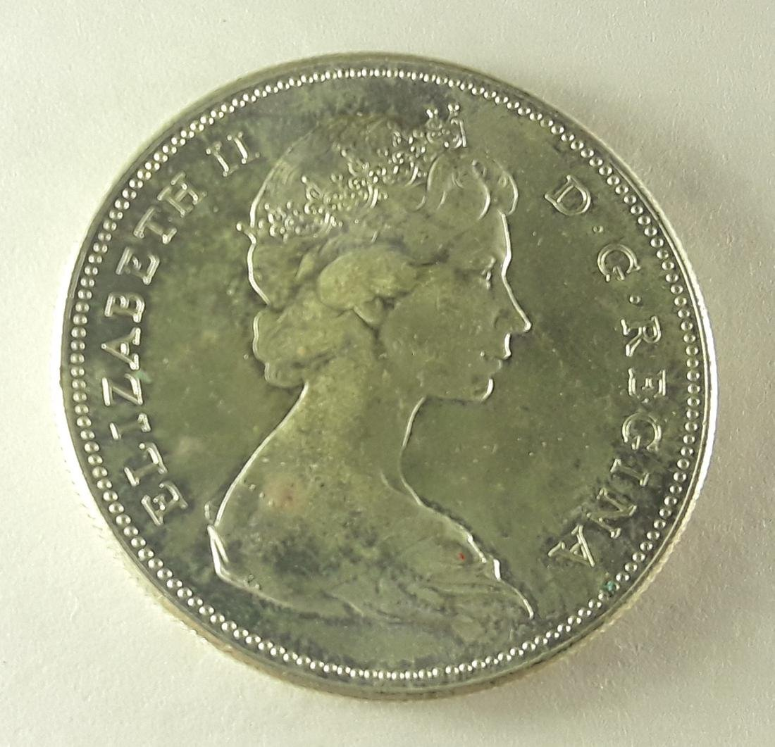 Canadian 1967 silver dollar Rotated Die Coin