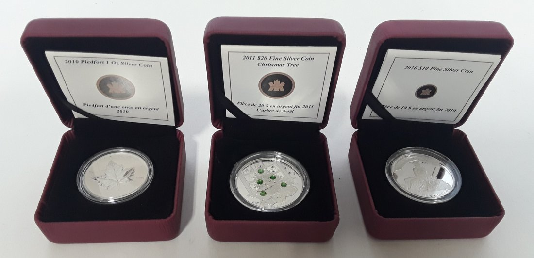 Canadian Group of Silver Dollars and RCMP Silver Coins - 2