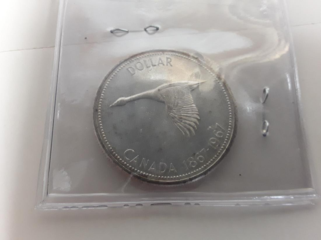 Canadian 1967 silver dollar Rotated Die Coin - 2