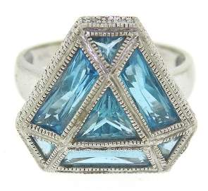 Glowing White Gold Blue Topaz and Diamond Ring