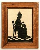 Cut Silhouette of a Lady Sewing