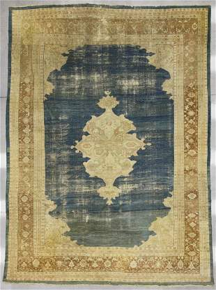 Early Oriental Carpet with Blue Field