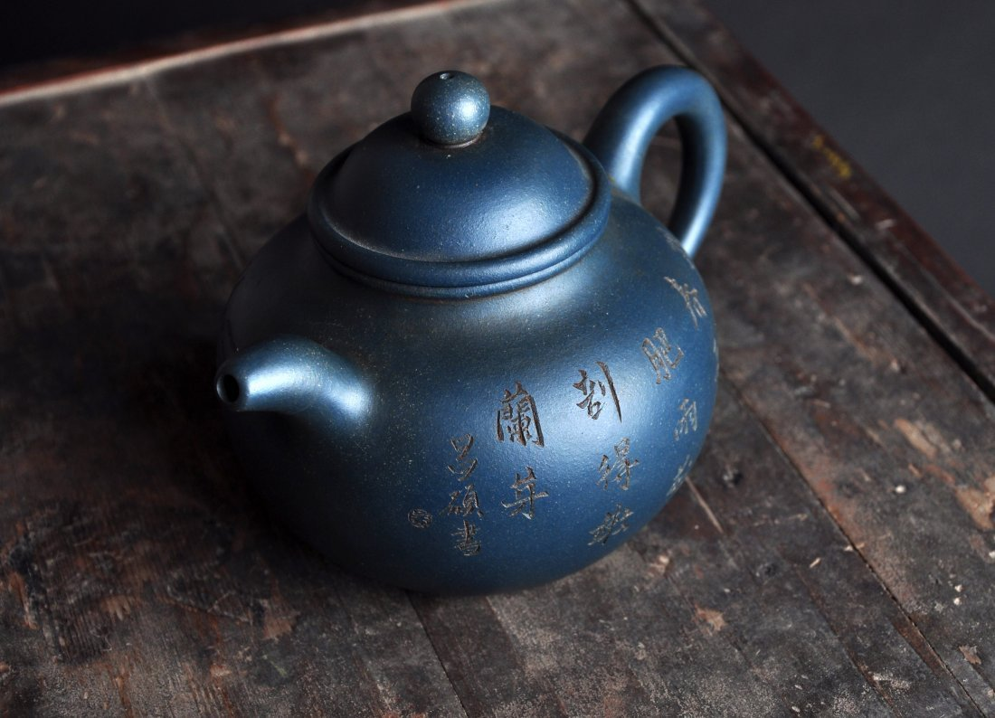 A Carved Calligraphy Clay Tea Pot with 'Wu Changshuo'