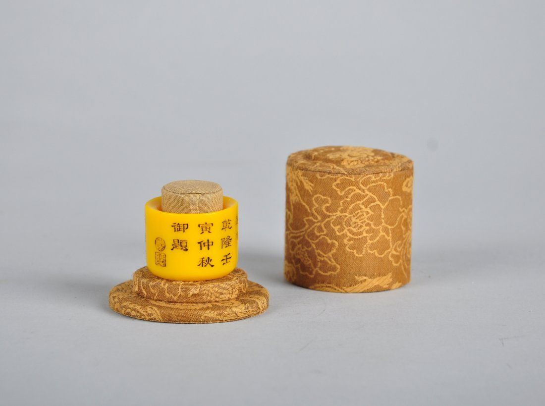 A Yellow Glass Thumb Ring with Imperial Poem