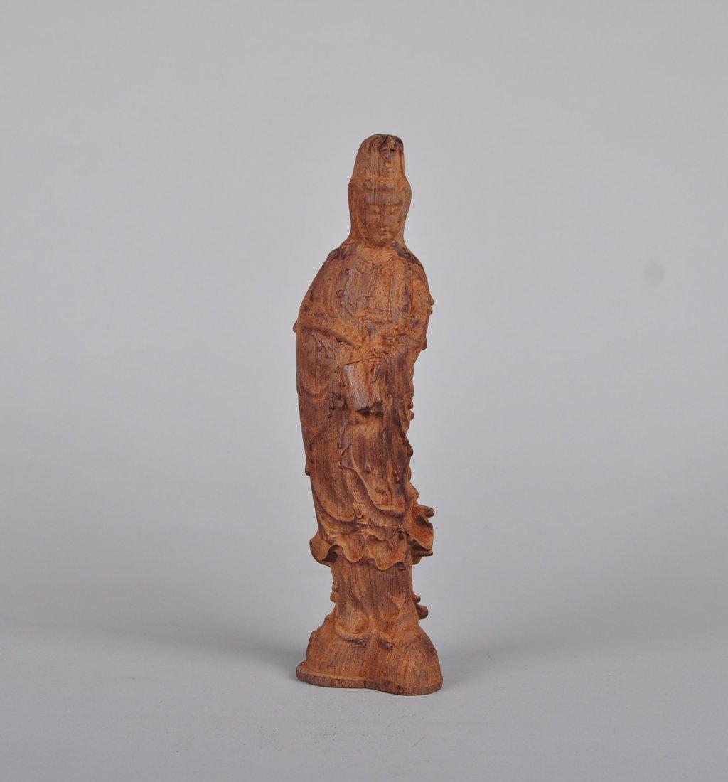 A Sandalwood Guanyin Figure