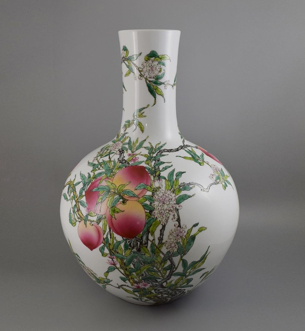 A FAMILLE ROSE 'NINE PEACHES' VASE, QIANLONG MARK BUT
