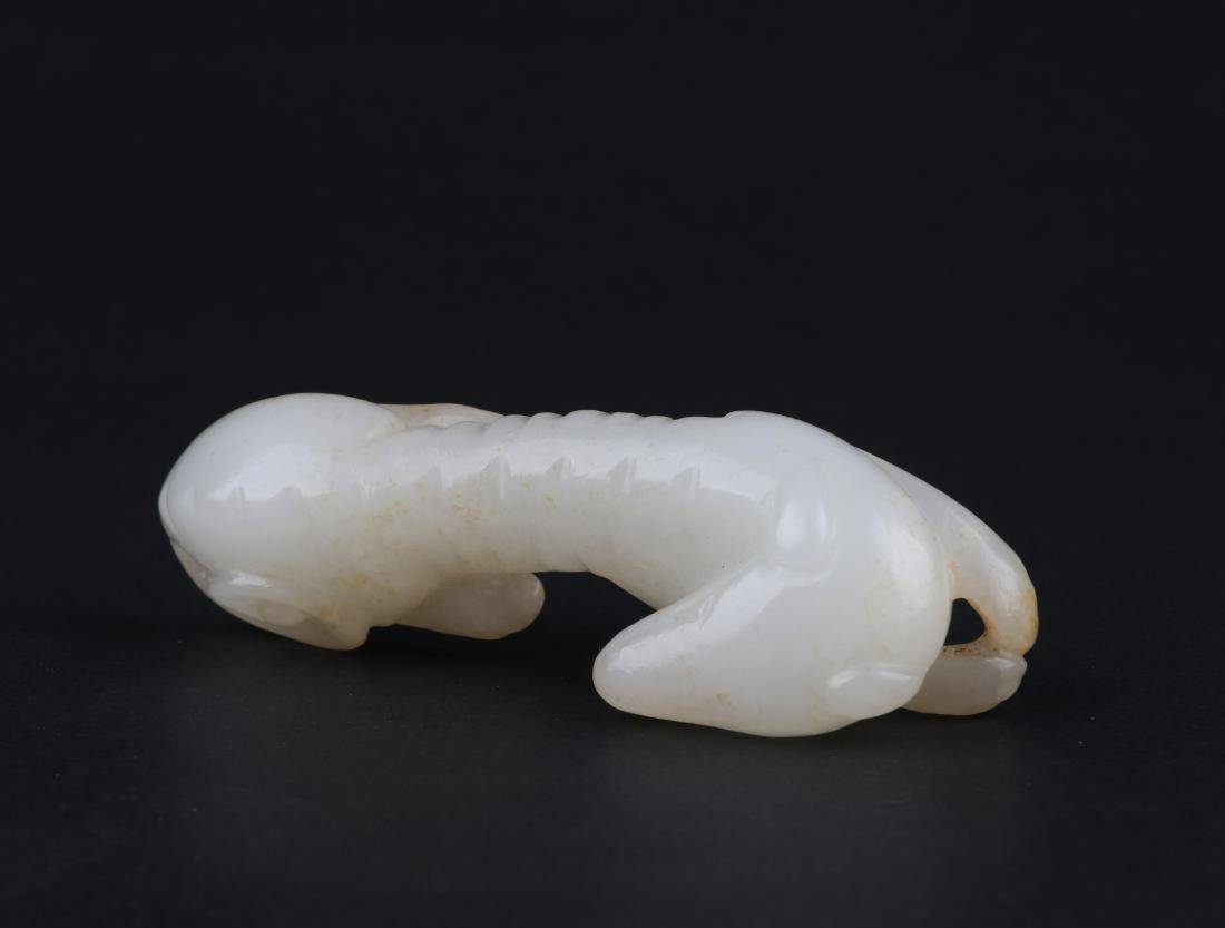 A CARVED WHITE JADE DOG, QING DYNASTY - 9