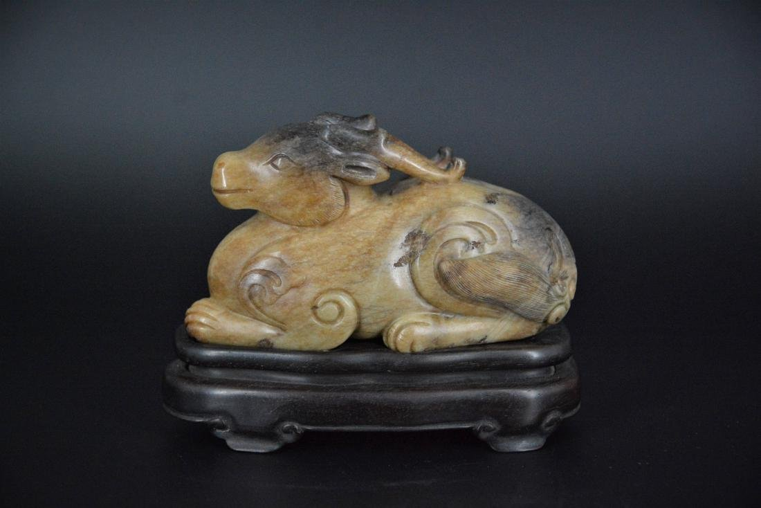 A CHINESE CARVED JADE MYTHICAL BEAST, QING DYNASTY