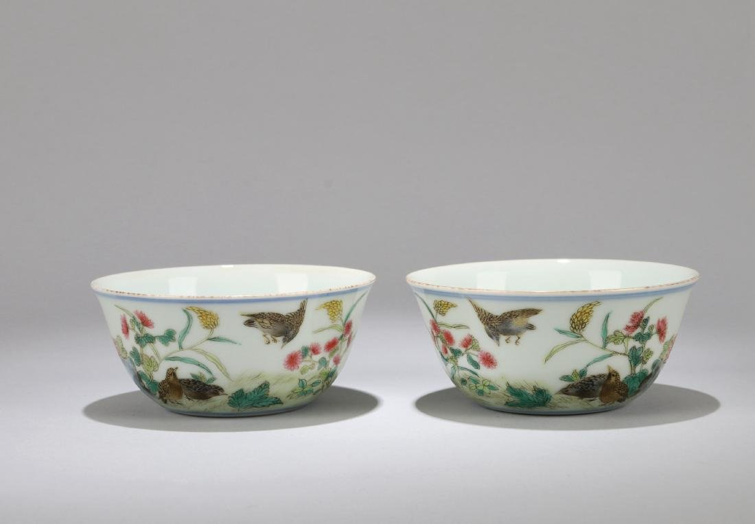 A PAIR OF CHINESE FAMILLE ROSE CUPS, QIANLONG MARK