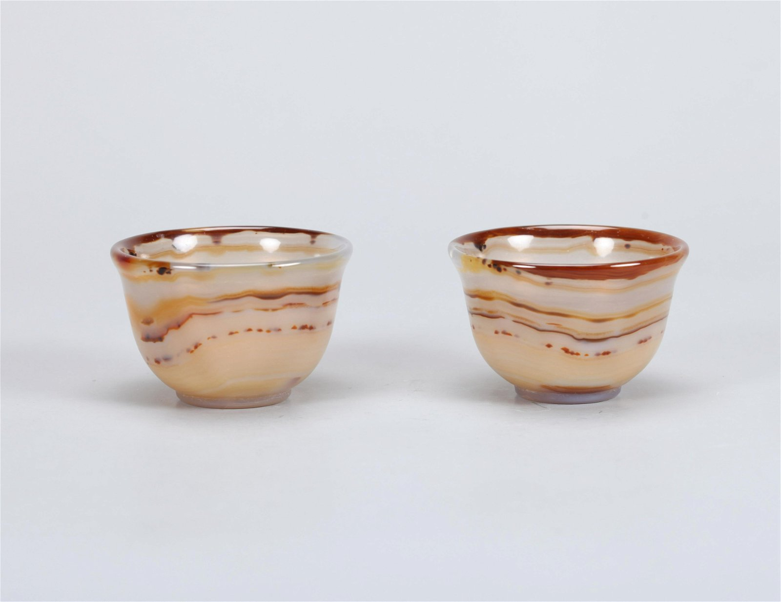 A PAIR OF CHINESE CARVED AGATE CUSP, QING DYNASTY