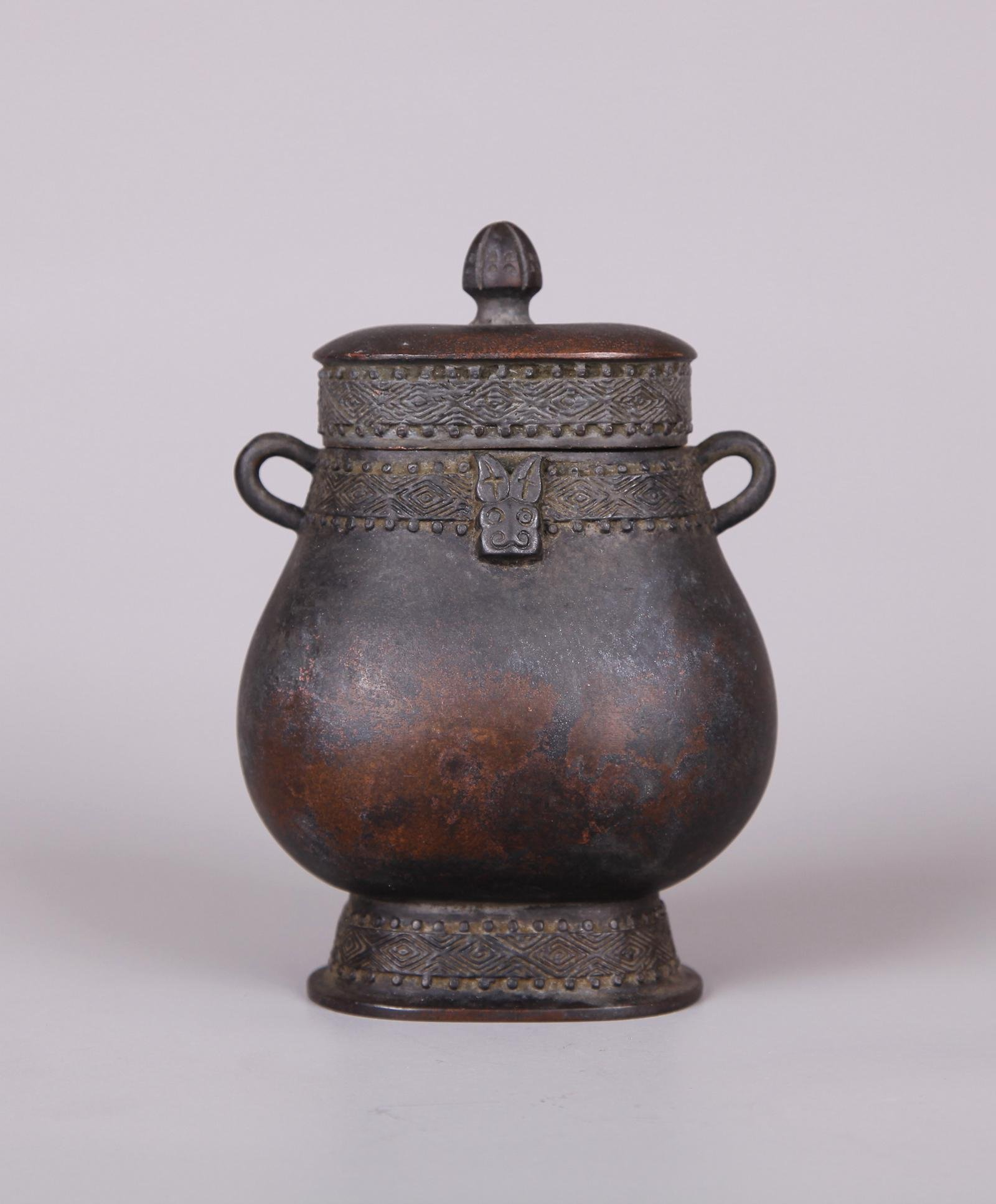 A CHINESE BRONZE HU-FORM VASE, XUANDE MARK