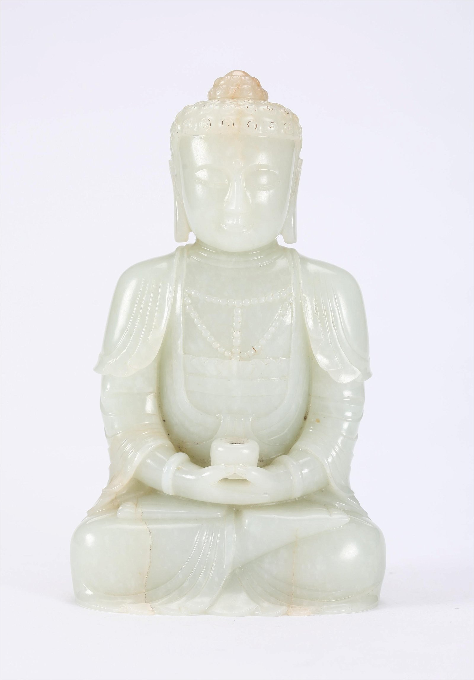 A CHINESE CARVED WHITE JADE FIGURE OF BUDDHA, QIANLONG