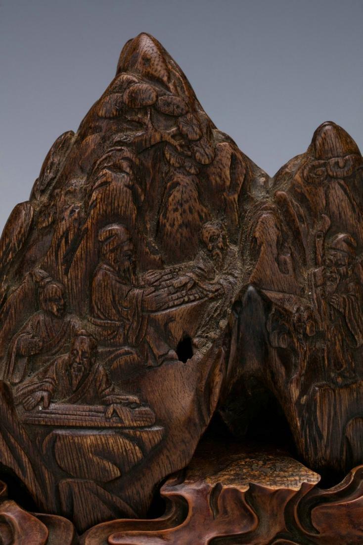Agilawood sculpture of figure stories - 2