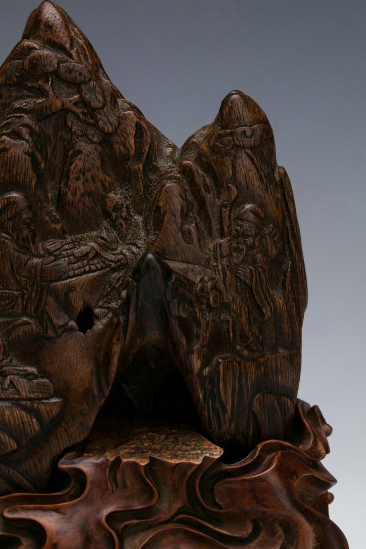 Agilawood sculpture of figure stories - 3