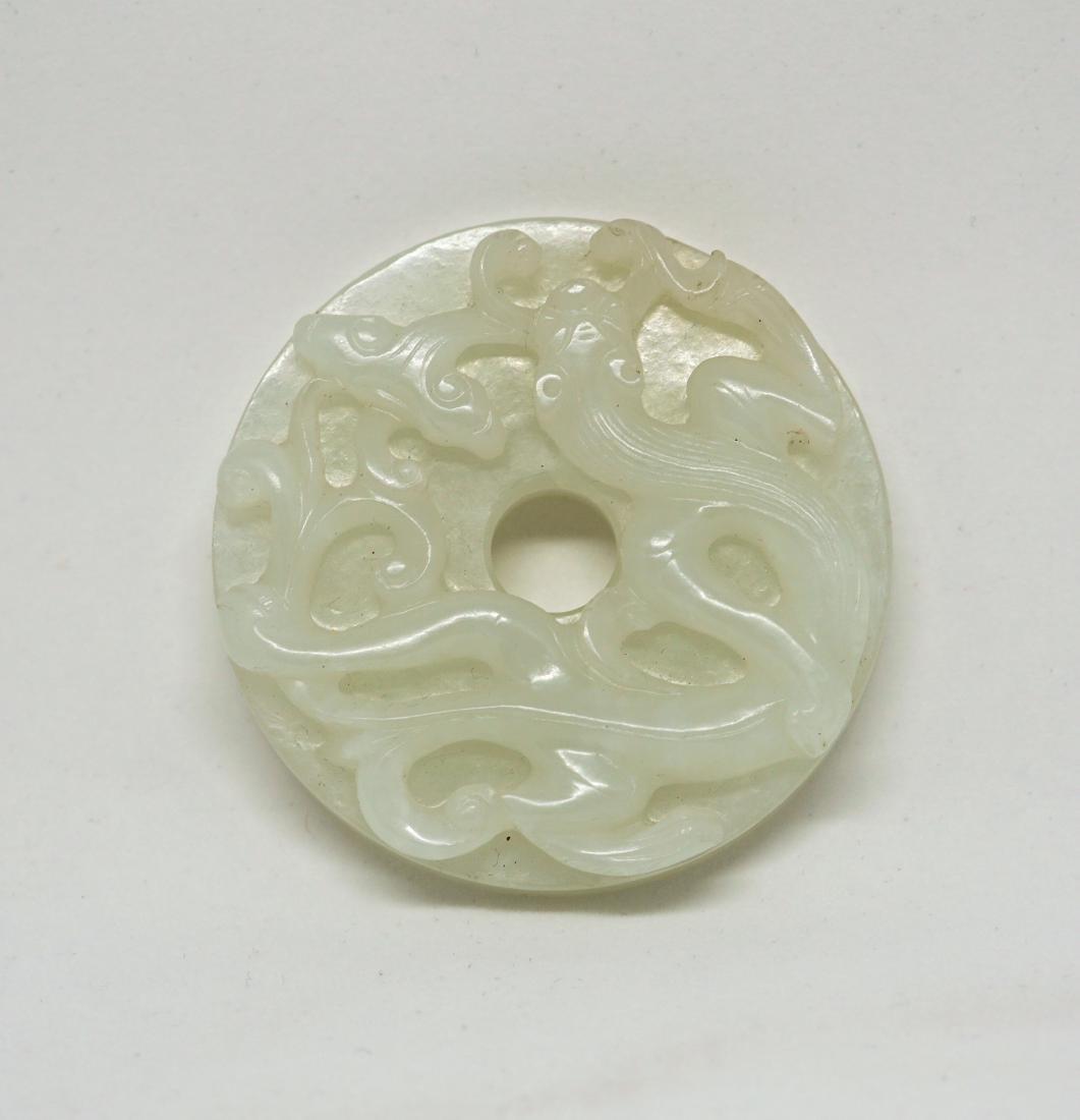 A Chinese White Jade Bi Disc