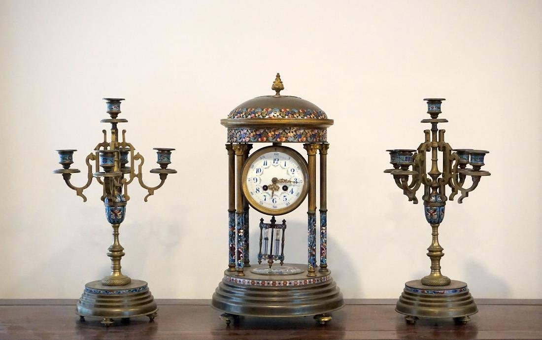 A LargeFrench Cloisonné Clock with Two Candle Holders