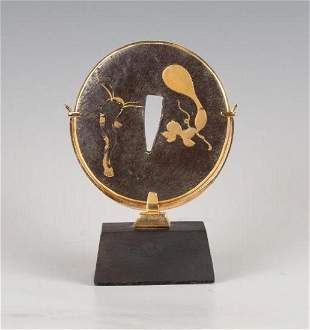 A Japanese Iron Tsuba in Gold Mount by Potter Mellen