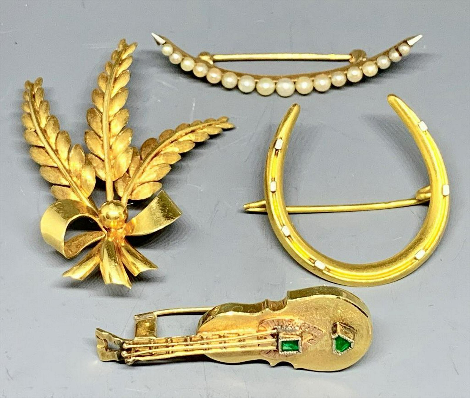 Four Gold Brooches Including an 18K Tiffany and Co. Pin