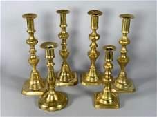 Six Assorted Antique Brass Candlesticks