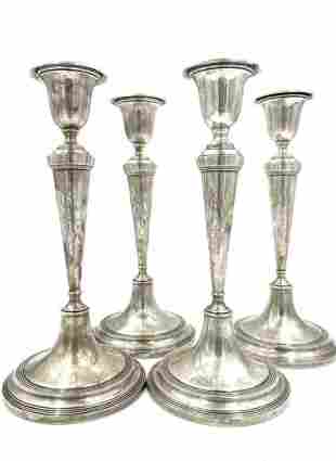 Four Sterling Candlesticks, Richard M.Woods and Company