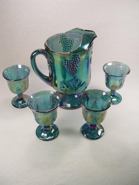 16: Carnival Glass Pitcher & 4 Glasses.