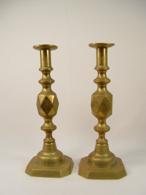 1006: Pair of King of Diamonds Brass Push-up Candlestic