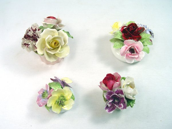 1002: Group of  4 Porcelain Flowers.