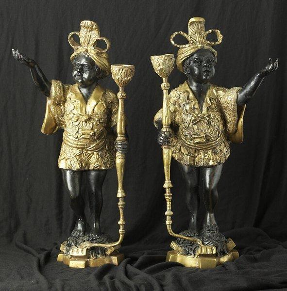 1023: Pair of Figural Bronze Candlesticks, C1940s.