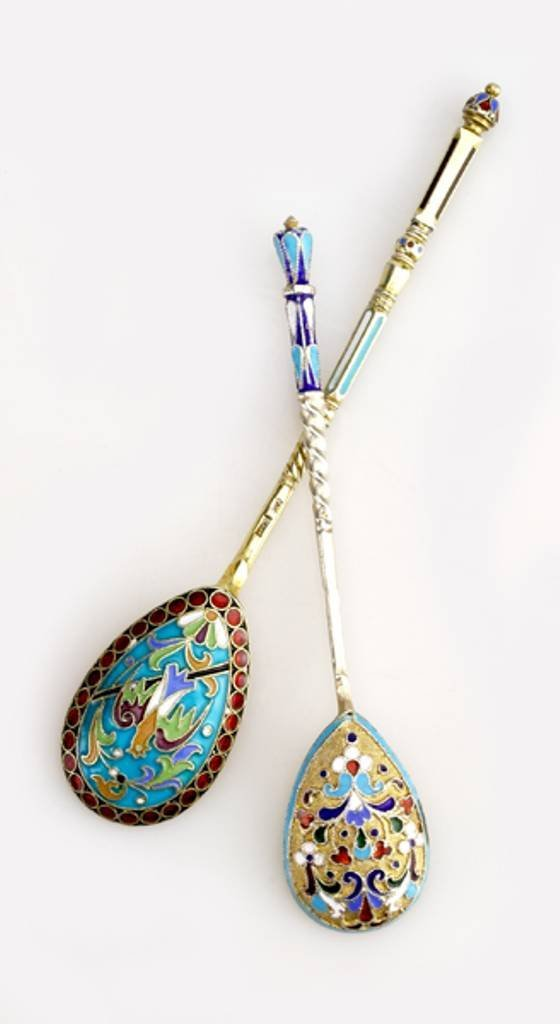 13: Two Russian gilded silver and shaded enamel tea spo
