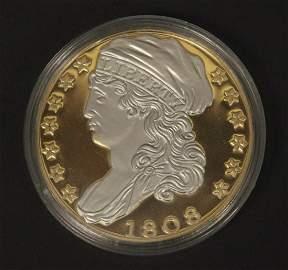 American Mint Platinum Accented Replica Coin