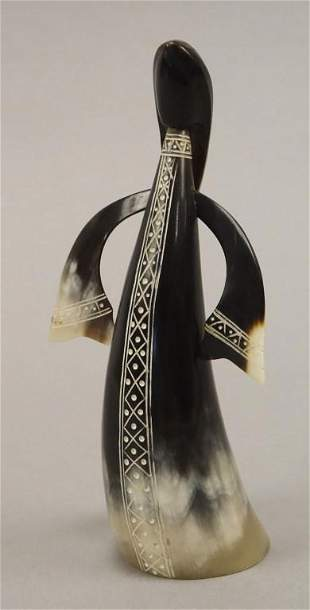 Carved Cow Horn Statue