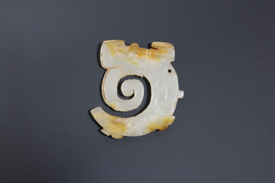 A Hetian White Jade Dragon-Form Pendant