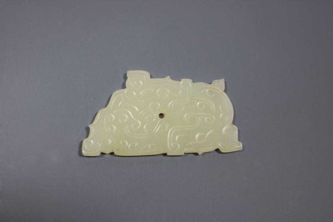 A Hetian Celandon Jade Dragon-Form Pendant