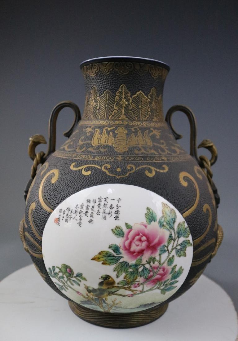 A Bronze Glazed Jar With Flower Pattern