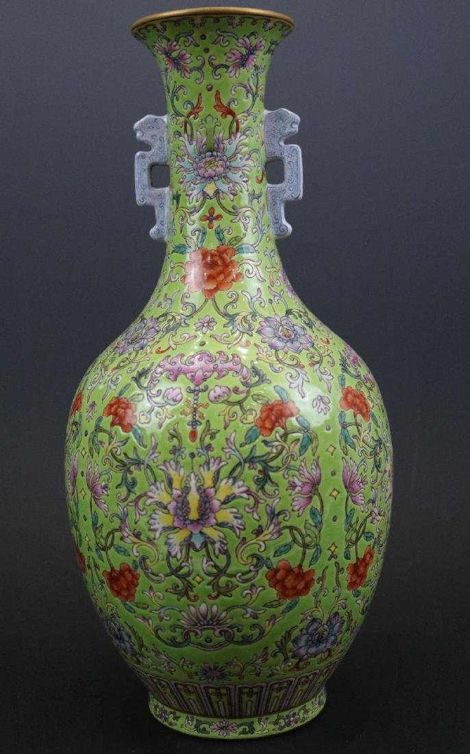 Qianlong Mark,A Famille Rose Vase With Two Handles