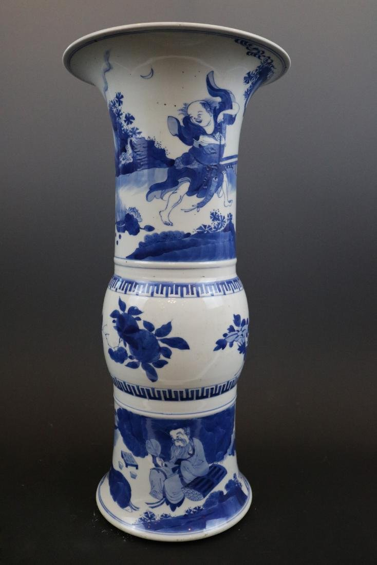 A Blue And White Vase With Human Pattern