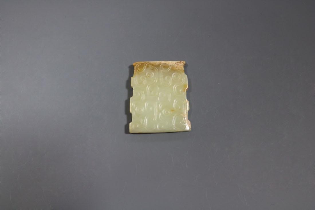 A Hetian Celandon Jade Dragon-Form Pendant, Western