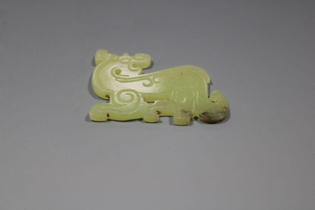 A Hetian Bluish Yellow Jade Dragon-Form Pendant,