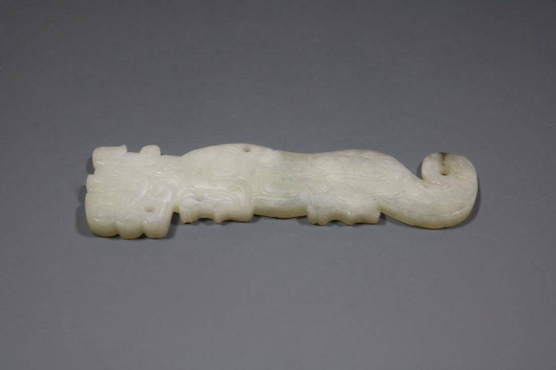 A Hetian White Jade Tiger-Form Pendant, Spring And