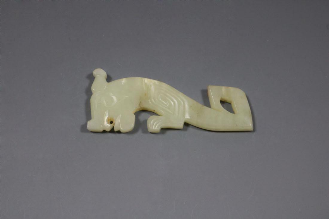 A Hetian Celandon Jade Tiger-Form Pendant, Shang